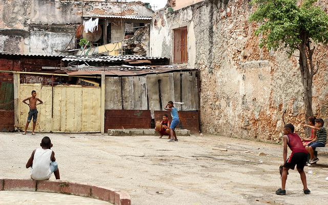 Kids in Havana, Cuba playing a game of baseball.